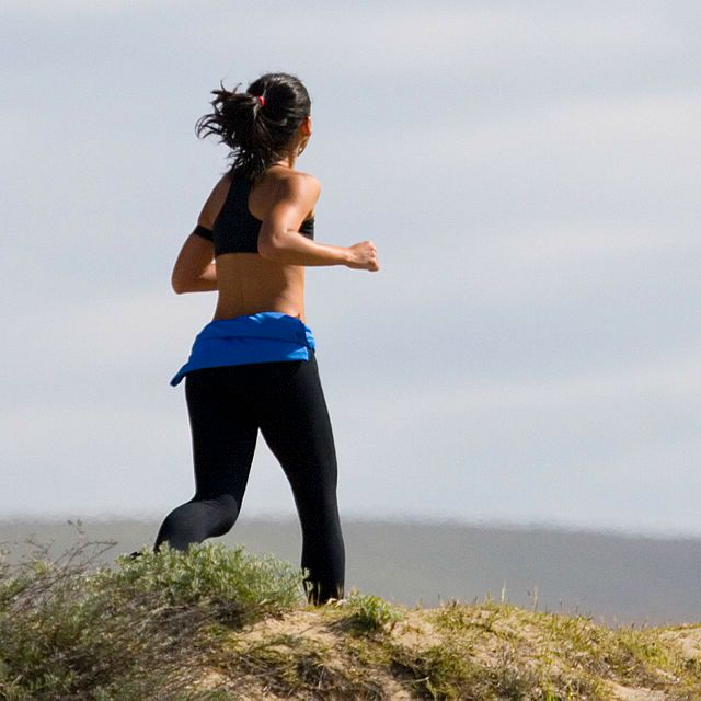 Jogging_Woman_in_Grass_500x500